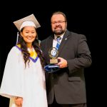 President Richard Karsten '81 awards Donna Kim with the Alumni Award.